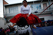 Cholita wrestlers fight during a private show at a house in La Paz, Bolivia, Saturday, July 10, 2010. (Photo Dado Galdieri)
