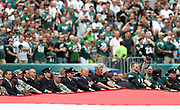 United States Vice President Joe Biden holds his hand over his heart as he joins police, firefighters, members of the military, and Philadelphia Eagles players who hold a full-field sized American flag stretched over the field in memory of the lives lost on the 15th anniversary of the 9/11 terror attack on the United States before the Philadelphia Eagles 2016 NFL week 1 regular season football game against the Cleveland Browns on Sunday, Sept. 11, 2016 in Philadelphia. The Eagles won the game 29-10. (©Paul Anthony Spinelli)