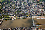 Nederland, Limburg, Gemeente Maastricht, 27-05-2013; <br /> De historische binnenstad en langs de de Maasboulevard de rivier de Maas met rechts de Sint Servaasbrug en links de fiets- en voetgangersbrug Hoge Brug (architect René Greisch) naar Wyck en de nieuwe wijk Céramique. Goed te zien is het Vrijthof met de rode toren van de Sint Janskerk en de Sint Servaasbasiliek. <br /> The Old Town of Maatricht and the river Maas (Meuse) along the Maasboulevard and left St. Servaas Bridge, on the other bank the residential district Wyck.<br /> luchtfoto (toeslag op standaardtarieven);<br /> aerial photo (additional fee required);<br /> copyright foto/photo Siebe Swart.