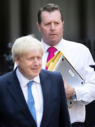 © Licensed to London News Pictures. 23/07/2019. London, UK. Mark Spencer MP, new chief whip, walks with newly elected Conservative Party leader Boris Johnson waves at party headquarters after attending a reception. Photo credit: Peter Macdiarmid/LNP