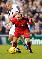 Photo: Leigh Quinnell.<br /> West Bromwich Albion v Coventry City. Coca Cola Championship. 16/12/2006. Coventrys Colin Cameron holds off West Broms Nigel Quashie.