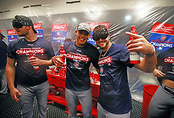 September 27, 2017 - St. Louis, MO, USA - Chicago Cubs relief pitcher Justin Grimm (52), shortstop Addison Russell (27), and center fielder Albert Almora Jr. (5), third baseman Kris Bryant (17), celebrate their team's division clinch with a win over the St. Louis Cardinals on Wednesday, Sept., 27, 2017 at Busch Stadium in St. Louis, Mo. (Credit Image: © Nuccio Dinuzzo/TNS via ZUMA Wire)