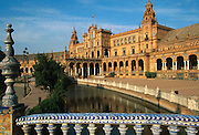SPAIN, ANDALUSIA, SEVILLE Plaza de Espana, built in 1929 for the Ibero American Fair in Maria Luisa Park, tiled bridges cross lagoons