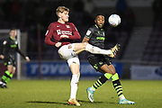 Northampton Town midfielder Ryan Watson (8) clears the ball under pressure from Forest Green Rovers midfielder Ebou Adams (14) during the EFL Sky Bet League 2 match between Northampton Town and Forest Green Rovers at the PTS Academy Stadium, Northampton, England on 14 December 2019.
