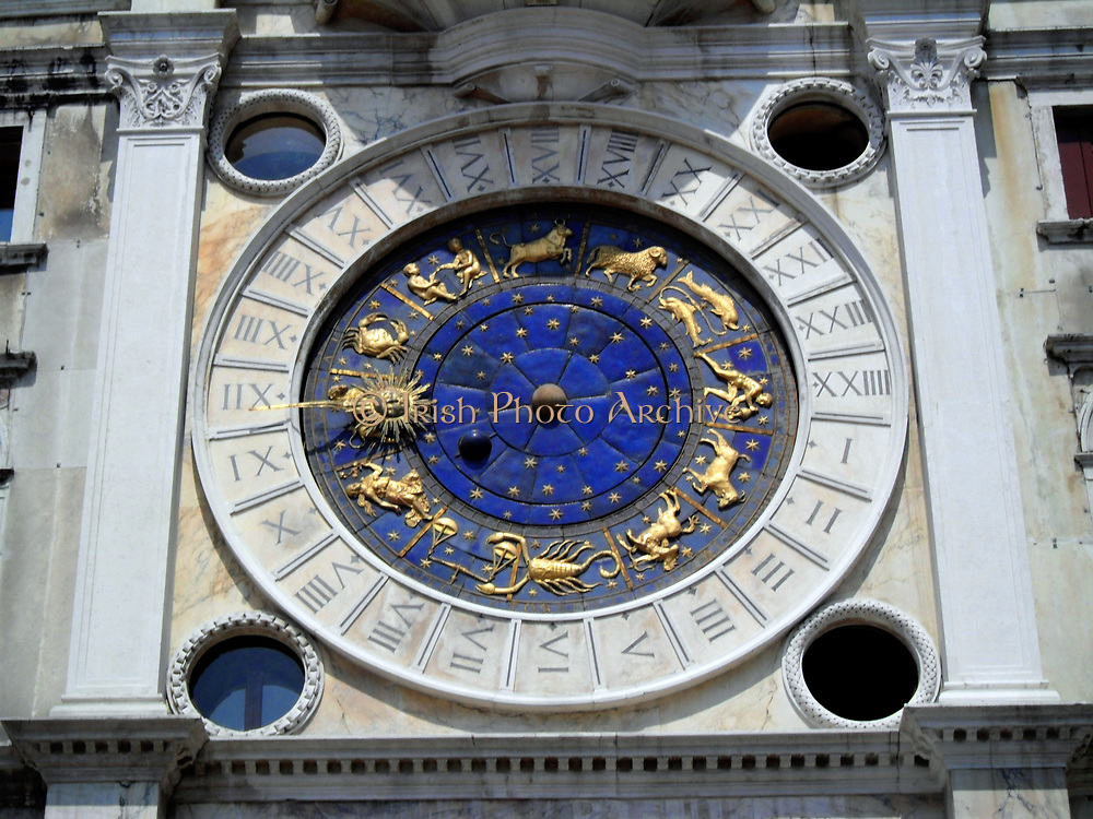Detail on the St Mark's Clock tower  Venice. The early renaissance building is on the North side of the Piazza San Marco at the entrance to the Merceira. It is comprised of a tower and two lower buildings either side.