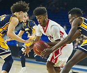 Watertown High School  senior Julio Fulcar fights for the ball with Saint Mary's sophomore Lisandro Pacheco (left) and junior Chibuikem Onwuogu during the MIAA Division 3 North sectional final at the Tsongas Center in Lowell, March 10, 2018. Watertown won the game, 44-36.   [Wicked Local Photo/James Jesson]