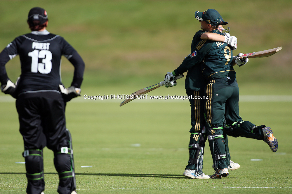 Rachel Priest looks on as Julie Hunter and Erin Osborne celebrate after Australia won the match off the last ball, New Zealand White Ferns v Australia, Rosebowl cricket series, One day international, Queenstown Events Centre, Queenstown. 3 March 2010. Photo: William Booth/PHOTOSPORT
