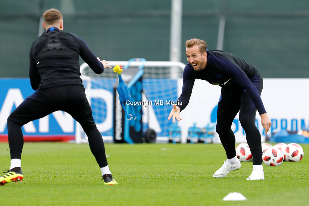 SAINT PETERSBURG, RUSSIA - JULY 10: Harry Kane (R) of England national team plays with toy rooster during an Englang national team training session ahead of the 2018 FIFA World Cup Russia Semi Final match against Croatia at Stadium Spartak Zelenogorsk on July 10, 2018 in Saint Petersburg, Russia. (MB Media)