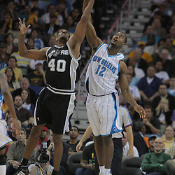 17 December 2008: New Orleans Hornets center Hilton Armstrong (12) and San Antonio Spurs center Kurt Thomas (40) fight for possession during a NBA regular season game between the Western Conference rivals the San Antonio Spurs and the New Orleans Hornets at the New Orleans Arena in New Orleans, LA..