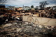 The remains of the Roms residence. At least 111 houses burned down in the Breezy Point neighborhood of the Rockaways as Hurricane Sandy ravaged the beach community. During the storm, Thomas Rom had to evacuate his family using a surfboard to get them away from their burning house.