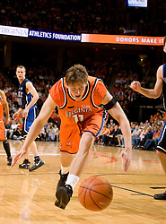 Virginia forward Laurynas Mikalauskas (11) lunges for a loose ball on the baseline against Duke.  The Virginia Cavaliers men's basketball team fell to the #6 Duke Blue Devils 86-70 at the University of Virginia's John Paul Jones Arena in Charlottesville, VA on March 5, 2008.