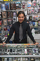 Portrait of man working in mobile phone shop