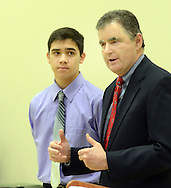 Former Congressman Mike Fitzpatrick (right) speaks about YMCA summer camp counselor Michael Stemen (left), 16, and his experiences with the YMCA, during the grand opening of the Warminster YMCA Tuesday, January 31, 2017 in Warminster. Pennsylvania. (Photo by William Thomas Cain)