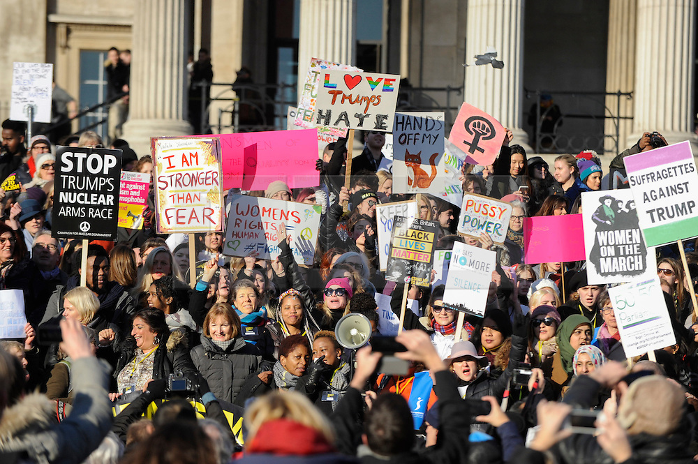 © Licensed to London News Pictures. 21/01/2017. London, UK. Tens of thousands of women arrive in Trafalgar Square during  the Women's March in central London.  The event, alongside others taking place worldwide, is a protest against gender inequality. Photo credit : Stephen Chung/LNP