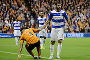 Charlie Austin helps Scott Golbourne off the floor during the Sky Bet Championship match between Wolverhampton Wanderers and Queens Park Rangers at Molineux, Wolverhampton, England on 19 August 2015. Photo by Alan Franklin.