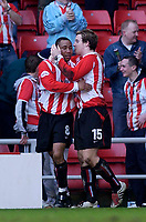 Photo. Glyn Thomas.<br /> Sunderland v West Ham United.<br /> Nationwide Division 1.<br /> Stadium of Light, Sunderland. 13/03/2004.<br /> Sunderland's Jeff Whitley (L) celebrates his goal and Sunderland's second with Sean Thornton.