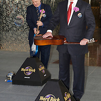 MACAU, CHINA - JUNE 01:  Businessmen James Packer (R) prepares to smash a Spanish guitar during the Hard Rock Hotel opening ceremony, as part of the acts of the opening of his and Lawrence Ho's 'City of Dreams' casino on June 1, 2009 in Cotai, Macau. The new 420,000 square foot casino, built on marshland 9km from Macao's traditional casino district but over the road from the world's largest casino 'Sands Venetian Macao', hopes to lure customers to the new casino area. 'City of Dreams' will offer over 500 gambling tables alongside its 3 hotels, a shopping mall and digital fish which swim in an electronic aquarium know as 'The Bubble'.  Photo by Victor Fraile / studioEAST