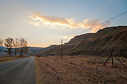 Road and fence, Drakensberg Mountains, South Africa.