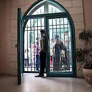 The public waiting in front of the doors of Hebron theater; as during all the tour, the theather will be full