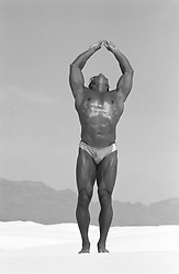 male bodybuilder posing outdoors in White Sands, NM