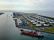 Nederland, Zuid-Holland, Rotterdam, 14-09-2019; Yangtzehaven met Maasvlakte Olie Terminal (MOT), links de drie tanks van Gate terminal. Gate terminal voor dient voor LNG import. De tanker voor de kade vervoert ruw olie.<br /> Yangtzehaven with Maasvlakte Oil Terminal (MOT), including the three tanks of the Gate terminal for LNG import.<br /> <br /> luchtfoto (toeslag op standard tarieven);<br /> aerial photo (additional fee required);<br /> copyright foto/photo Siebe Swart