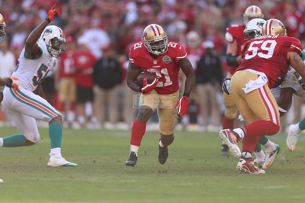 San Francisco 49ers running back Frank Gore (21) in action against the Miami Dolphins during an NFL game at Candlestick Park on December 9, 2012 in San Francisco, CA.  (Photo by Jed Jacobsohn)