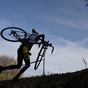 Competitors in action as they climb a hill in the CCAP High School and Juniors race during the The 3rd Annual Newtown Cyclocross Race in the Fairfield Hills and the Town's Municipal Center. Newtown, Connecticut, USA. 15th November 2015. Photo Tim Clayton