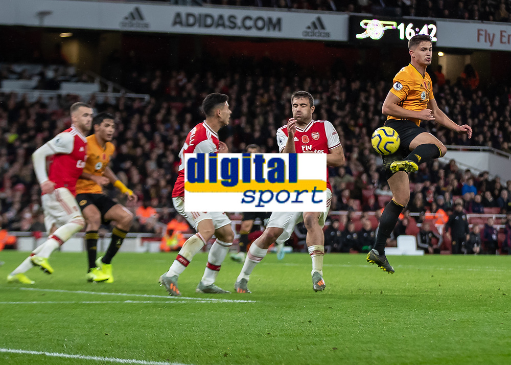 Football - 2019 / 2020 Premier League - Arsenal vs. Wolverhampton Wanderers<br /> <br /> Leander Dendoncker (Wolverhampton Wanderers) with a cheeky flick on from a corner at The Emirates Stadium.<br /> <br /> COLORSPORT/DANIEL BEARHAM