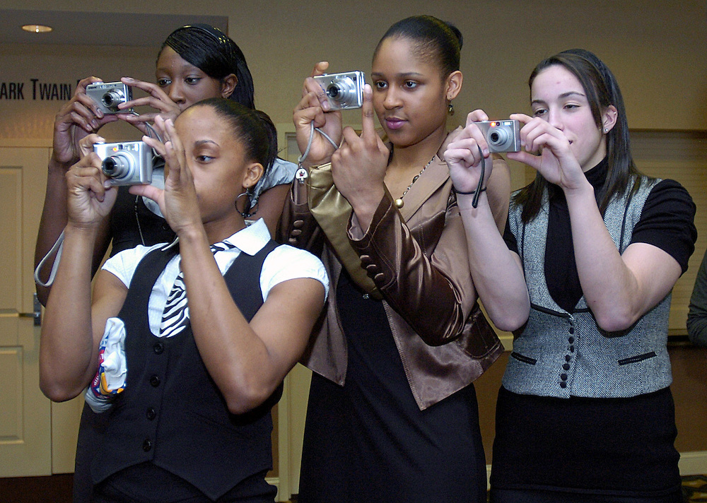 Connecticut players Lorin Dixon, front left, Tina Charles, back left, Maya Moore, center, and Jacquie Fernandes, right, take photos of their teammates prior to the Big East Awards, in Hartford, Conn., Friday, March 7, 2008.   (AP Photo/Jessica Hill)