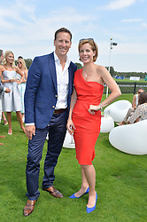 DARCEY BUSSELL and BRENDAN COLE at the Audi International Polo at Guards Polo Club, Windsor Great Park, Egham, Surrey on 26th July 2014.