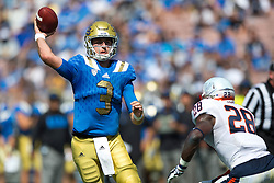 PASADENA, CA - SEPTEMBER 05:  Quarterback Josh Rosen #3 of the UCLA Bruins throws a pass for a touchdown over safety Wilfred Wahee #28 of the Virginia Cavaliers during the third quarter at the Rose Bowl on September 5, 2015 in Pasadena, California. The UCLA Bruins defeated the Virginia Cavaliers 34-16. (Photo by Jason O. Watson/Getty Images) *** Local Caption *** Josh Rosen; Wilfred Wahee