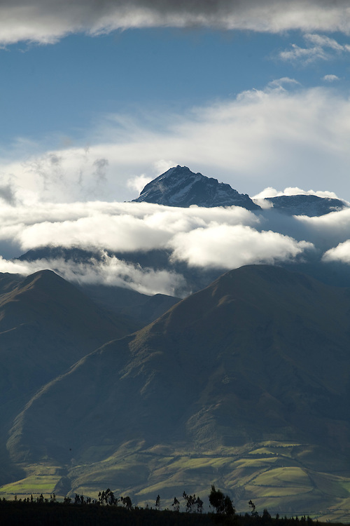 South America, Ecuador, Peguche, village of weavers near Otavalo, view of mountain peaks in clouds