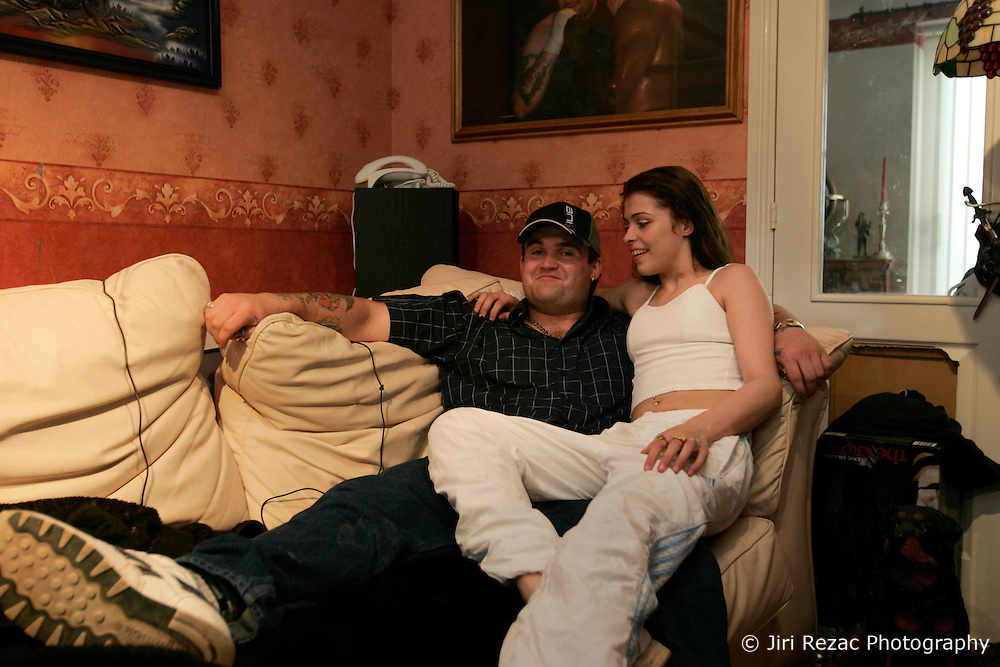 UK ENGLAND NORFOLK SWAFFHAM 14JUL05 - Micheal Carroll, a 22-year old binman who turned a millionnaire by winning £ 9.7 million in the National Lottery poses for photos with his girlfriend Sammy Howard (17) in their living room in Downham Market, Norfolk. The self-styled 'King of Chavs' was recently served with an anti-social behaviour order after driving through Downham Market in Norfolk firing ball bearings from his window.  ..jre/Photo by Jiri Rezac..© Jiri Rezac 2005..Contact: +44 (0) 7050 110 417.Mobile:  +44 (0) 7801 337 683.Office:  +44 (0) 20 8968 9635..Email:   jiri@jirirezac.com.Web:    www.jirirezac.com