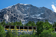 """Walk downhill from Eigergletscher train station (of the Jungfraujoch """"Top of Europe"""" railway) under the north face of the Eiger (3970m / 13,020 ft elevation) to Alpiglen station in Grindelwald Valley, Canton of Bern, Switzerland, the Alps, Europe. The Eiger has the biggest north face in the Alps: 1800 vertical meters (or 5900 ft) of rock and ice. The Swiss Alps Jungfrau-Aletsch region is honored as a UNESCO World Heritage Site.The Swiss Alps Jungfrau-Aletsch region is honored as a UNESCO World Heritage Site."""