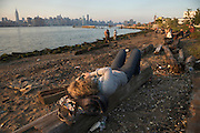 people watching midtown Manhattan from Williamsburg waterfront