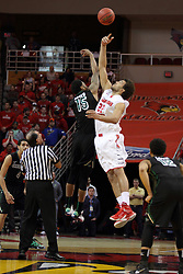18 March 2015:  Greg Mays and Reggie Lynch tip off the ball tossed by Tom O'Neill  during an NIT men's basketball game between the Green Bay Phoenix and the Illinois State Redbirds at Redbird Arena in Normal Illinois