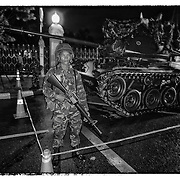 A soldier stand guard outside Government House in Bangkok, Thailand, Tuesday, Sept. 19, 2006. The Thai military launched a coup against Prime Minister Thaksin Shinawatra on Tuesday night, circling his offices with tanks and seizing control of TV stations and declaring a provisionla authority pledging loyalty to the King.  (David Longstreath)