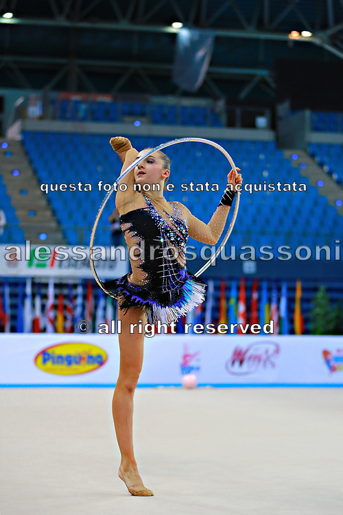 Volkova Ekaterina during qualifying at hoop in Pesaro World Cup 10 April 2015. Ekaterina was born in Vantaa, Finland, 1997. She is a Finnish individual rhythmic gymnast.