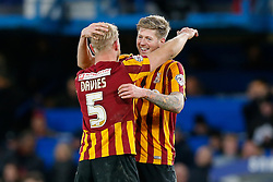 Andrew Davies and Jonathan Stead of Bradford City celebrate after Bradford City pull of a remarkable comeback from 2-0 down to win the match 2-4 and progress to the fifth round of the FA Cup - Photo mandatory by-line: Rogan Thomson/JMP - 07966 386802 - 24/01/2015 - SPORT - FOOTBALL - London, England - Stamford Bridge - Chelsea v Bradford City - FA Cup Fourth Round Proper.