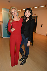 Left to right, STEPHANIE BILET and DAISY LOWE at Fashions for The Future presented by Oceana's Junior Council held at Phillips Auction House, 30 Berkeley Square, London on 19th March 2015.