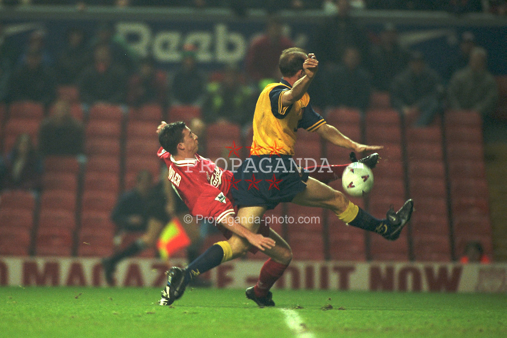 Liverpool, England - Wednesday, November 27th, 1996: Liverpool's Robbie Fowler and Arsenal's Steve Bould during the 4th Round of the League Cup at Anfield. (Pic by David Rawcliffe/Propaganda)