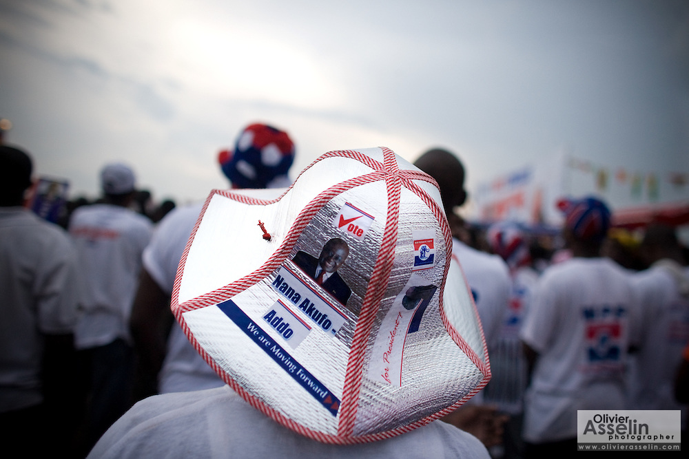 A supporter wears a hat portraying New Patriotic Party (NPP) presidential hopeful Nana Akufo-Addo during a campaign rally in Ghana's capital Accra on Friday December 5, 2008. Thousands of Ghanaians gathered in final rallies as they prepared to head to the polls on Sunday December 7 to elect a new government.