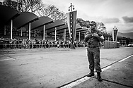 "A military looks at people waiting in queues to visit the remamins of Venezuela's President, Hugo Chávez in Caracas on the 9th March 2013. The queues to visit the Chávez lasted days and the waiting period could be over 24 hours period as thousands went to pay their last respects. Chávez ruled Venezuela for 14 years, passed away on the 5th March 2013.  He revolutionized not only his nation but also other countries in Latin America, with his political views and what he called the ""21st Century Socialism"", supported by the petrodollars from Venezuela's massive oil-reserves."