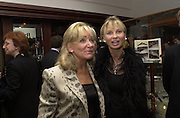 Daphne Scheder-Bieschin and Corina Sayn-Wittgenstein. Gunmaker's Boss and Co's launch party new Mayfair premises. Mount St. London. 12 December 2000. © Copyright Photograph by Dafydd Jones 66 Stockwell Park Rd. London SW9 0DA Tel 020 7733 0108 www.dafjones.com