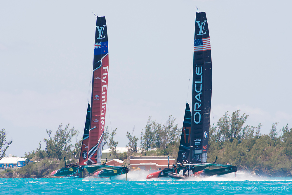 The Great Sound, Bermuda, 18th June. Oracle Team USA and Emirates Team New Zealand, race three on day two of the America's Cup.