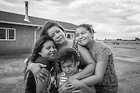 Jeannie James, Winslow and Window Rock , Arizona for The Shriver Report.   Jeannie cares for her grand daughters Kimey, Vanessa and Sue Begaye and works for the Navajo Nation social services department.   Her ex-husband Jonathan Logg is also seen in one photo.