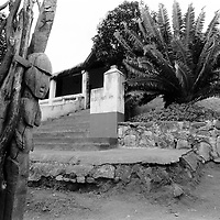 880220GM01:SAFRICA:CULTURE:PEOPLE:RELIGION:YOUTH:HOMELANDS:04AUG90 - A carved pole marks the entrance to the Rain Queen's courtyard and a Madjadji cycad decorates the verandah of the house where she receives guests in the Drakensberg mountains of the Nort