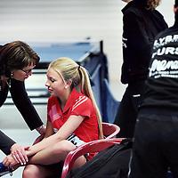 Nederland, Rotterdam , 12 april 2015.<br /> Tafeltennister Laura van Oppen wordt getroost na haar verlies van Jacintha de Hoop in de wedstrijd Heerlen tegen FVT uit Rotterdam.<br /> Foto:Jean-Pierre Jans