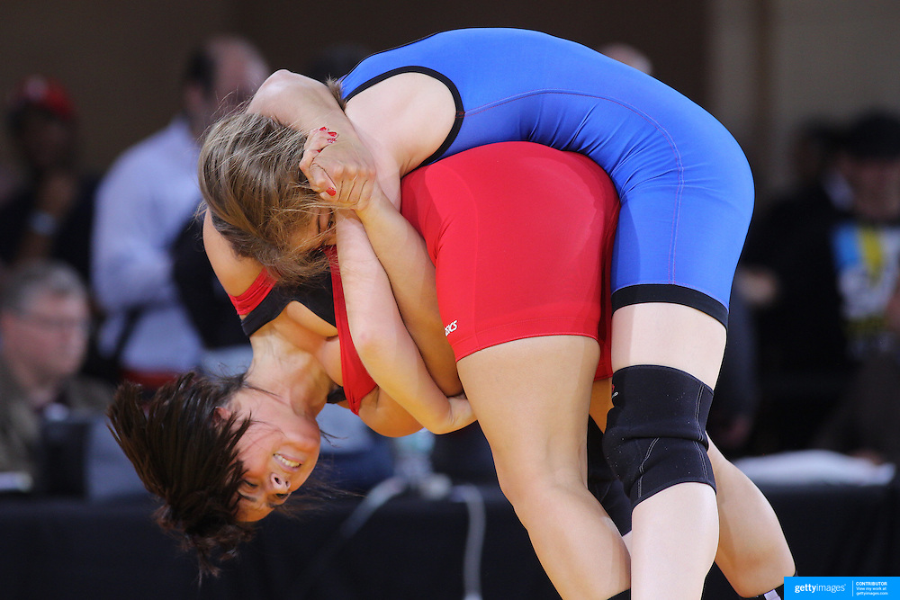 Rosemary Flores, Curtis High School (Straten Island) and Sarah Andresen, Hunter College High School, (Manhattan), in action during a youth wrestling exhibition during the Beat the Streets Gala which included wrestlers from USA, Iran and Russia competing at Grand Central Terminal as part of the Beat the Streets Gala. Billed ?The Rumble On The Rails,? the international wrestling event showcased competition as part of World Wrestling Month. Vanderbilt Hall, Grand Central Station, Manhattan,New York. USA. 15th May 2013. Photo Tim Clayton