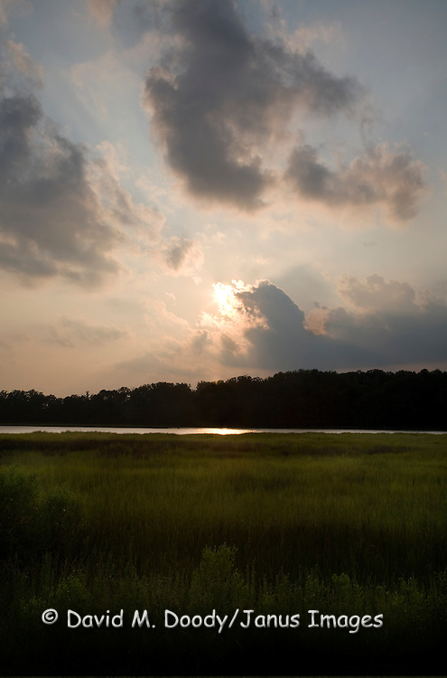 Summer sunset over tidal wetlands at College Creek near Jamestown along the Colonial Parkway National Historic Park Virginia.